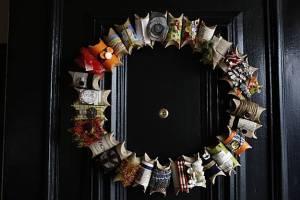 Megumi Inouye and her homemade wreath of toilet paper rolls