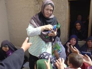 Dr. Rahela Kaveer handing out pamphlets