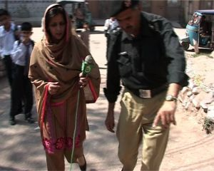 Farzana with investigating person in Peshaway recently
