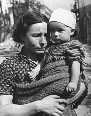 Polish mother and child during bombing of Warsaw, 1939 by Julian Bryan