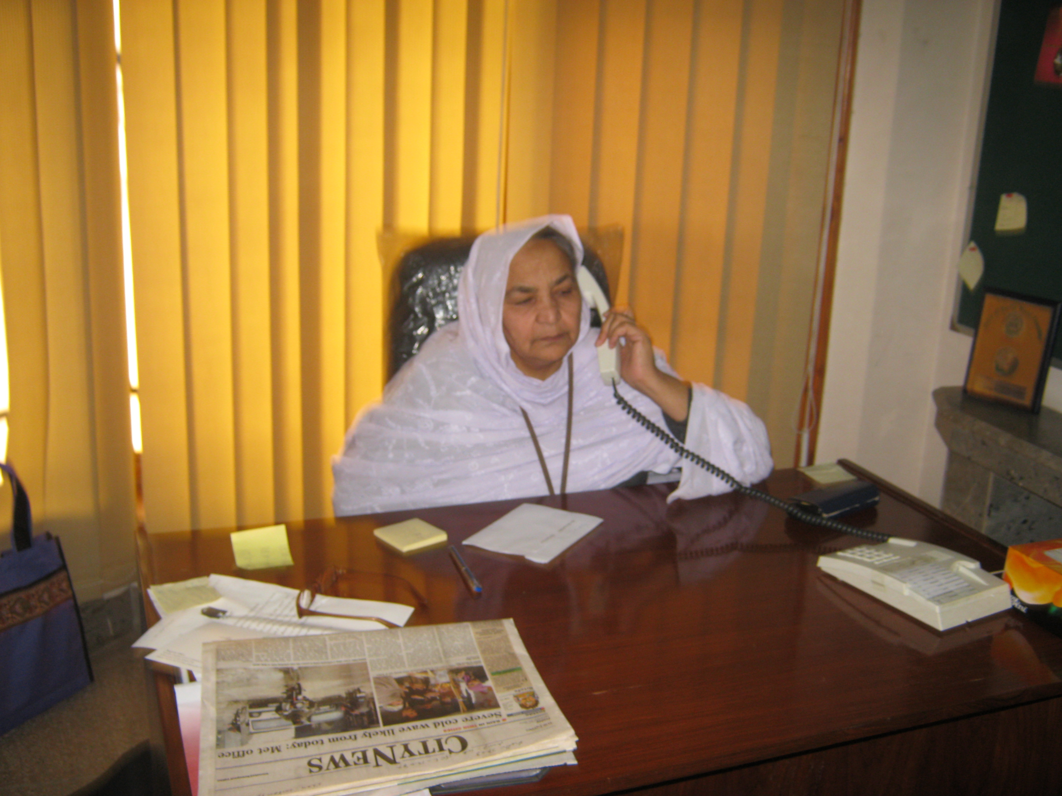 Maryam Bibi at her desk